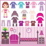 Bambola di carta con un insieme dei vestiti e di una stanza Fotografia Stock