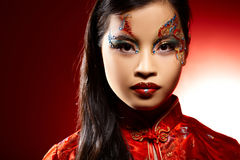 Bambola di plastica asiatica Immagine Stock