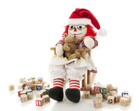 Bambola di straccio che oscilla il suo bambino Fotografia Stock