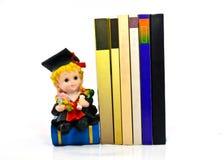 Bambola e libri della resina di graduazione Immagine Stock Libera da Diritti
