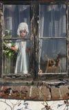 bambola in finestra Fotografia Stock