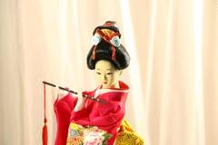Bambola giapponese della ragazza con fondo rosa Fotografie Stock Libere da Diritti