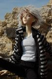 Bambola a sfere con lo strabismo della seduta dell'occhiata Fotografia Stock Libera da Diritti