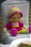 Bambola in una sedia Fotografia Stock