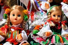 Bambole in costumi pieghi Immagini Stock