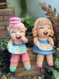 Bambole dell'argilla per il giardino della decorazione Fotografia Stock