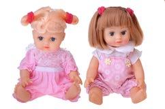Bambole delle ragazze che si siedono in vestito variopinto Fotografie Stock Libere da Diritti