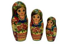 Bambole di babushkas o di Matrioshka su un fondo bianco Fotografia Stock