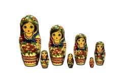 Bambole di babushkas o di Matrioshka su un fondo bianco Immagini Stock