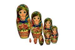 Bambole di babushkas o di Matrioshka su un fondo bianco Fotografia Stock Libera da Diritti