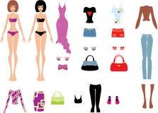 Bambole di carta con i vestiti Fotografia Stock Libera da Diritti