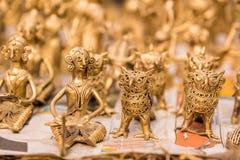 Bambole dorate del giocattolo di ottone Fotografia Stock