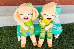 Bambole in giardino Fotografia Stock Libera da Diritti