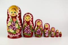 Bambole russe di incastramento su una priorità bassa bianca Immagine Stock Libera da Diritti