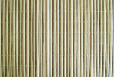 Bamboo. Perfectly arranged into a wall with silk thread Royalty Free Stock Photo
