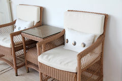 Bamboo arm-chairs with cushions Stock Photography