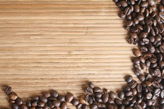 Bamboo background with coffee beans Royalty Free Stock Photo