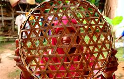 Bamboo basket craftswoman while doing his work stock photo