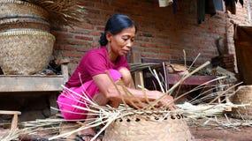 Bamboo basket craftswoman while doing his work stock photos