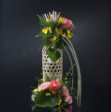Bamboo basket decorated with flowers Stock Photos
