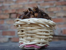 Bamboo basket full of cloves. Hot spice cloves in bamboo basket, one of famous indian food ingredient Stock Images