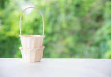 Bamboo basket on green Royalty Free Stock Photos