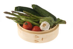 Bamboo basket with vegetables royalty free stock photo