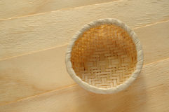 Bamboo basket on wood pieces Stock Photos