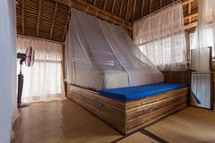 Bamboo bedroom. Bamboo bed in a bamboo bedroom in a bamboo house Stock Image