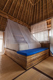 Bamboo bedroom. Bamboo bed in a bamboo bedroom in a bamboo house Stock Photos