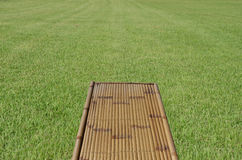 Bamboo bench and grass Stock Photo
