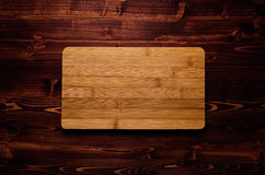 Bamboo blank sign board on brown vintage wood plank, top view. Mock up for company identity, restaurant menu, business card. Stock Photos