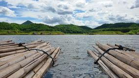 Bamboo boat. Bamboo rafting in the reservoir Stock Photos
