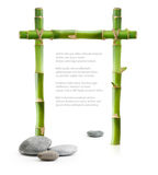 Bamboo border made of stems and stones Royalty Free Stock Photo