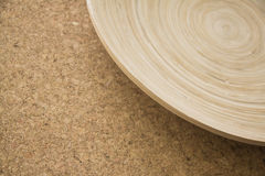 Bamboo bowl on beige cork texture Royalty Free Stock Image
