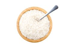 Bamboo bowl with rice and steel spoon Stock Photography