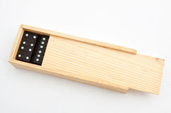 Bamboo box with domino. On white background with clipping path Royalty Free Stock Photos