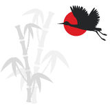 Bamboo branches and flying crane bird Stock Images