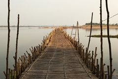 Bamboo bridge across Mekong river. Old traditional bamboo bridge across Mekong river on sunset, Kampong Cham, Cambodia royalty free stock images