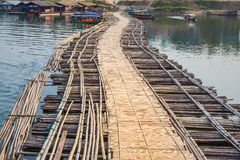 Bamboo bridge across the river Stock Photo