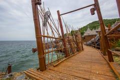 Bamboo bridge and Borneo style huts at Koh Sichang,Chonburi,Thailand Royalty Free Stock Photography