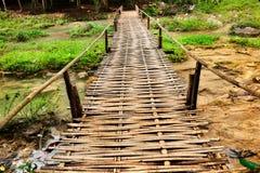 Bamboo bridge crossing stream Stock Photo