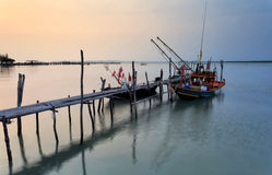 Bamboo bridge and fishing boat during sunset Royalty Free Stock Photos