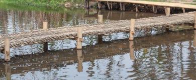 Bamboo bridge. Little bamboo bridge over river Stock Photo