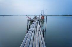 Bamboo bridge and moving fishing boat using  long exposure techn Stock Photography