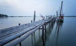 Bamboo bridge and moving fishing boat using  long exposure techn Royalty Free Stock Images