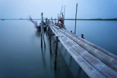 Bamboo bridge and moving fishing boat using  long exposure techn Royalty Free Stock Photo