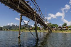Bamboo bridge on the Nam Song river in Vang Vieng, Laos. Asia royalty free stock image