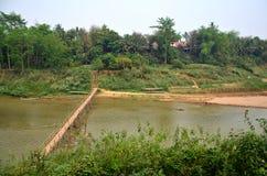 Bamboo bridge for people walk crossing mekong river Royalty Free Stock Images