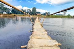 Bamboo bridge with sand bag in Chitwan National Park Nepal Royalty Free Stock Images